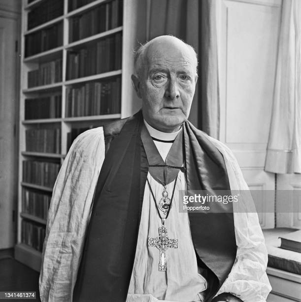 Cyril Garbett , recently appointed Archbishop of York, posed in his ceremonial robes at the Bishop's House in Winchester, England during World War II...