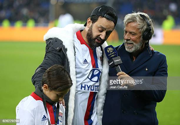 Cyril Hanouna and a young fan Hugo are interviewed by Laurent Paganelli of Canal Plus after kicking off the French Ligue 1 match between Olympique...