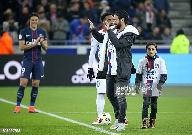 Cyril Hanouna and a young fan Hugo kick off the French Ligue 1 match between Olympique Lyonnais and Paris SaintGermain at Parc OL stadium on November...