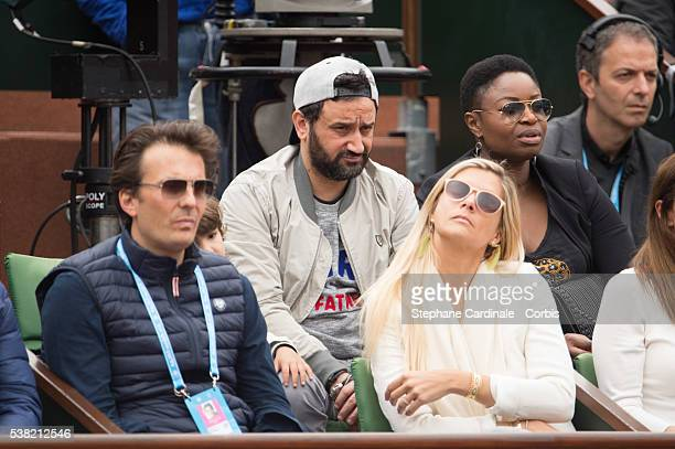 Cyril Hanouna and Yannick Bollore attend day Fourteen of the 2016 French Open at Roland Garros on June 3 2016 in Paris France