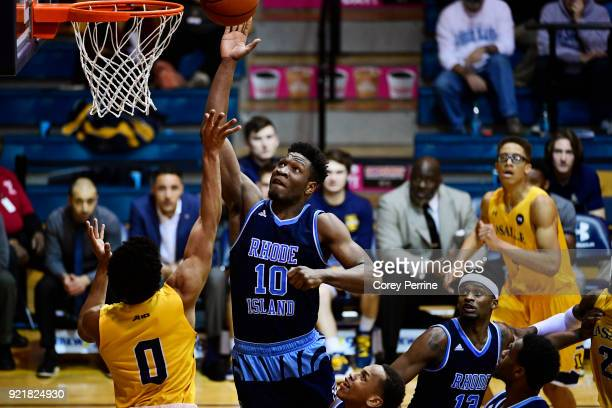 Cyril Langevine of the Rhode Island Rams shoots the ball against Pookie Powell of the La Salle Explorers during the second half at Tom Gola Arena on...
