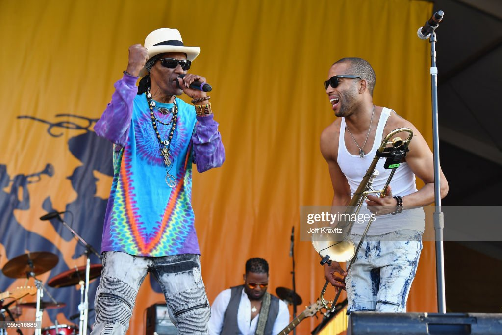 Cyril Neville (L) and Trombone Shorty & Orleans Avenue perform onstage during Day 7 of the 2018 New Orleans Jazz & Heritage Festival at Fair Grounds Race Course on May 6, 2018 in New Orleans, Louisiana.
