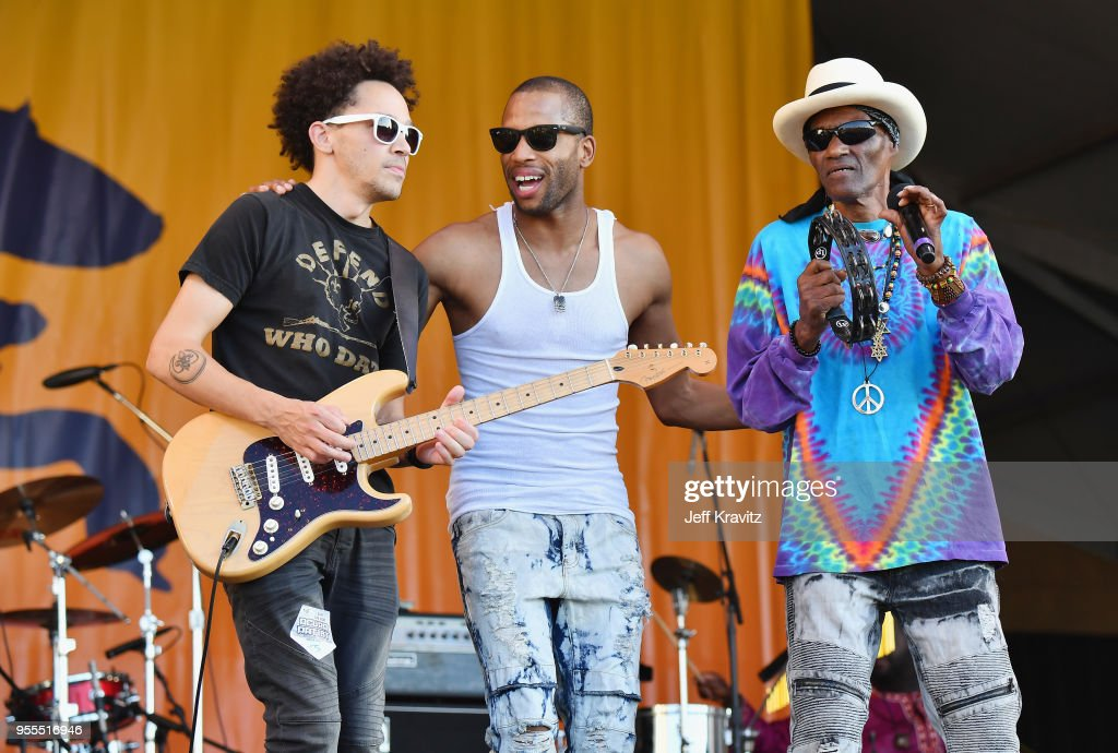 Cyril Neville (R) and Trombone Shorty & Orleans Avenue perform onstage during Day 7 of the 2018 New Orleans Jazz & Heritage Festival at Fair Grounds Race Course on May 6, 2018 in New Orleans, Louisiana.