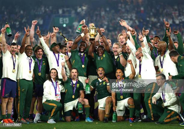 Cyril Ramaphosa President of South Africa lifts the Web Ellis Cup with Siya Kolisi of South Africa following their victory against England in the...