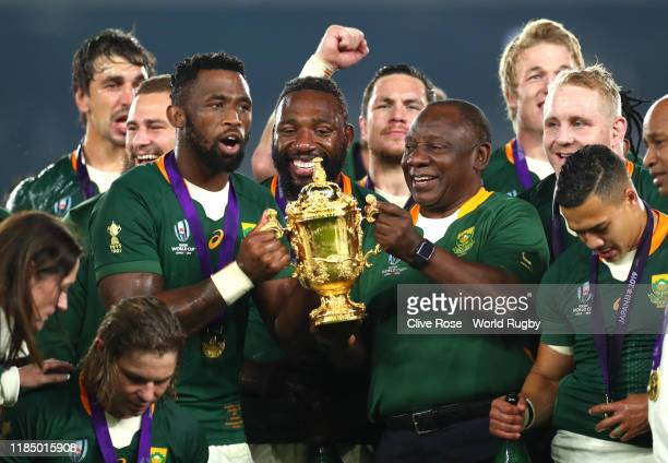 Cyril Ramaphosa, President of South Africa lifts the Web Ellis Cup with Siya Kolisi of South Africa following their victory against England in the...