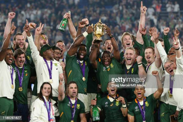 Cyril Ramaphosa President of South Africa lifts the Webb Ellis Cup with Siya Kolisi after their side win the Rugby World Cup 2019 Final between...