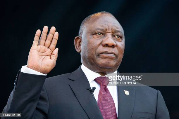 Cyril Ramaphosa raises his right hand as he takes the oath of office at his inauguration as South African President at Loftus Versfeld stadium in...
