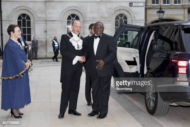 Cyril Ramaphosa South Africa's president center right greets Charles Bowman Lord Mayor of the City of London while arriving for the City of London...