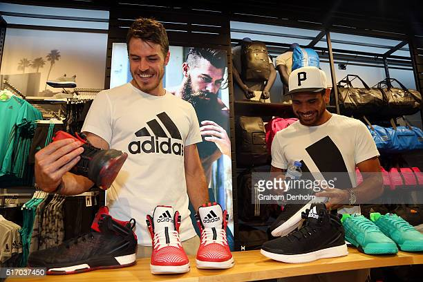 Cyril Rioli and Issac Smith of the Hawthorn Hawks check out some footwear at the adidas Bourke Street Store on March 23 2016 in Melbourne Australia