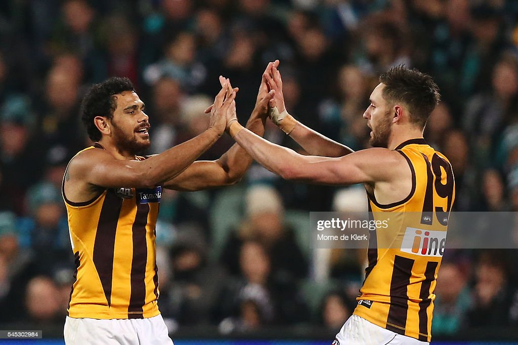 Cyril Rioli and Jack Gunston of the Hawks celebrate a goal during the round 16 AFL match between the Port Adelaide Power and the Hawthorn Hawks at Adelaide Oval on July 7, 2016 in Adelaide, Australia.