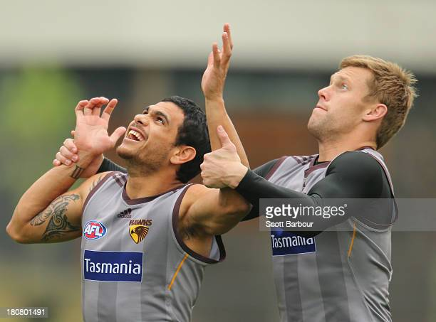 Cyril Rioli and Sam Mitchell compete for the ball during a Hawthorn Hawks AFL training session at Waverley Park on September 17, 2013 in Melbourne,...