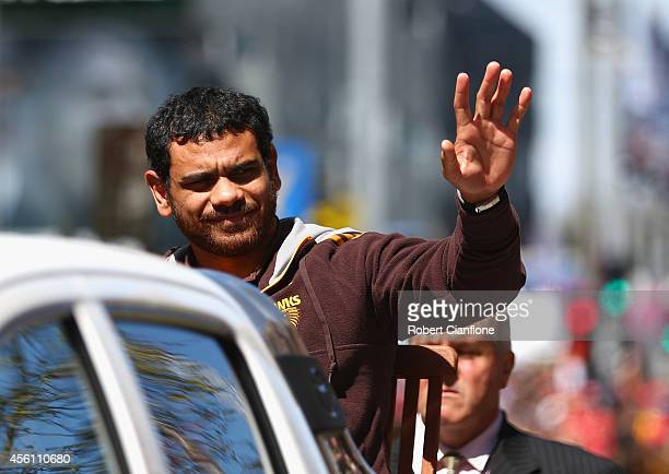 Cyril Rioli of Hawthorn waves to the fans during the 2014 AFL Grand Final Parade on September 26 2014 in Melbourne Australia