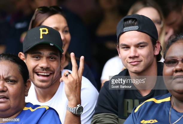 Cyril Rioli of the Hawks and Daniel Rioli of the Tigers watch the match from the crowd during the round two AFL match between the Western Bulldogs...