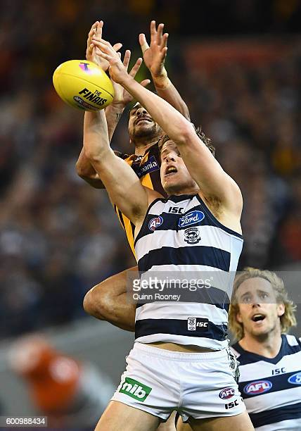 Cyril Rioli of the Hawks and Jake Kolodjashnij of the Cats compete for a mark during the 2nd AFL Qualifying Final match between the Geelong Cats and...