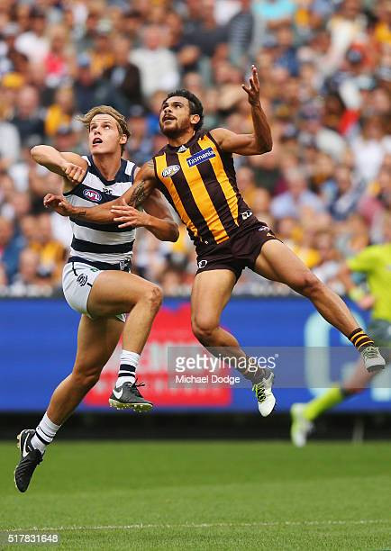 Cyril Rioli of the Hawks and Jake Kolodjashnij of the Cats compete for the ball during the round one AFL match between the Geelong Cats and the...