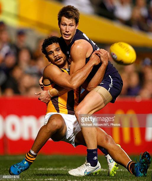 Cyril Rioli of the Hawks and Lee Spurr of the Dockers in action during the 2015 AFL First Preliminary Final match between the Fremantle Dockers and...