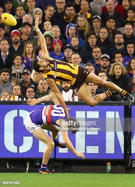 Cyril Rioli of the Hawks attempts to take a spectacular mark over Joel Hamling of the Bulldogs during the second AFL semi final between Hawthorn...