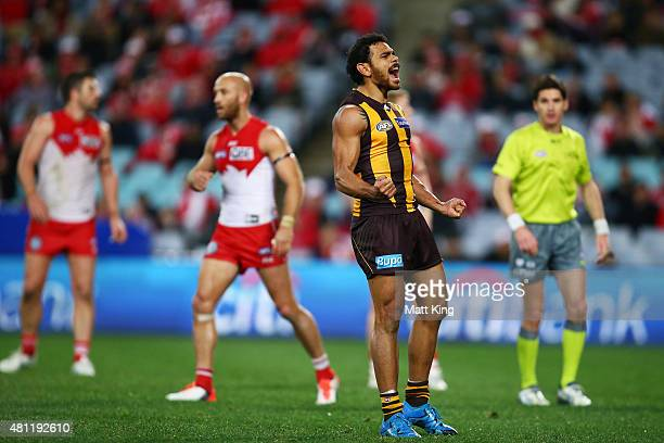 Cyril Rioli of the Hawks celebrates a goal during the round 16 AFL match between the Sydney Swans and the Hawthorn Hawks at ANZ Stadium on July 18...