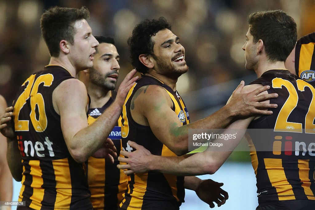Cyril Rioli of the Hawks (C) celebrates a goal during the round 20 AFL match between the Geelong Cats and the Hawthorn Hawks at Melbourne Cricket Ground on August 15, 2015 in Melbourne, Australia.