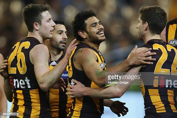 Cyril Rioli of the Hawks celebrates a goal during the round 20 AFL match between the Geelong Cats and the Hawthorn Hawks at Melbourne Cricket Ground...