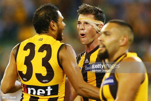 Cyril Rioli of the Hawks celebrates a goal Jaeger O'Meara during the round one AFL match between the Hawthorn Hawks and the Collingwood Magpies at...
