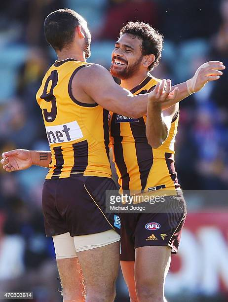 Cyril Rioli of the Hawks celebrates a goal with Shaun Burgoyne during the round three AFL match between the Hawthorn Hawks and the Western Bulldogs...