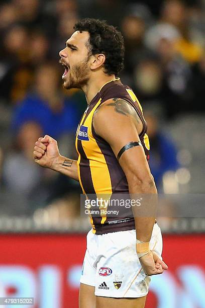 Cyril Rioli of the Hawks celebrates after kicking a goal during the round 14 AFL match between the Collingwood Magpies and the Hawthorn Hawks at...