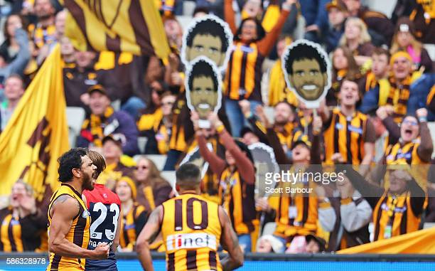 Cyril Rioli of the Hawks celebrates after kicking a goal during the round 20 AFL match between the Melbourne Demons and the Hawthorn Hawks at...