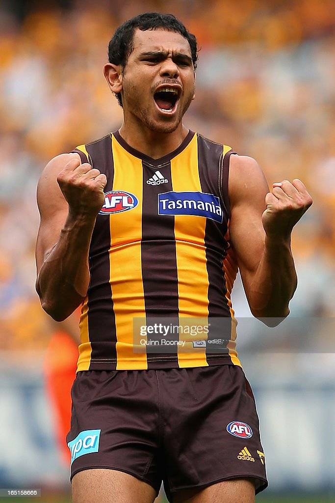 Cyril Rioli of the Hawks celebrates kicking a goal during the round one AFL match between the Hawthorn Hawks and the Geelong Cats at the Melbourne Cricket Ground on April 1, 2013 in Melbourne, Australia.