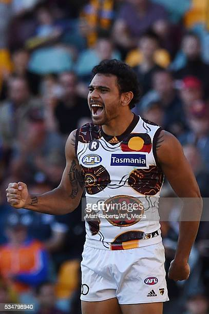 Cyril Rioli of the Hawks celebrates kicking a goal during the round 10 AFL match between the Brisbane Lions and the Hawthorn Hawks at The Gabba on...