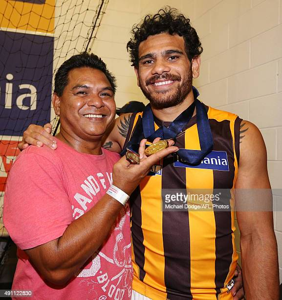 Cyril Rioli of the Hawks celebrates the win with dad Cyril during the 2015 AFL Grand Final match between the Hawthorn Hawks and the West Coast Eagles...