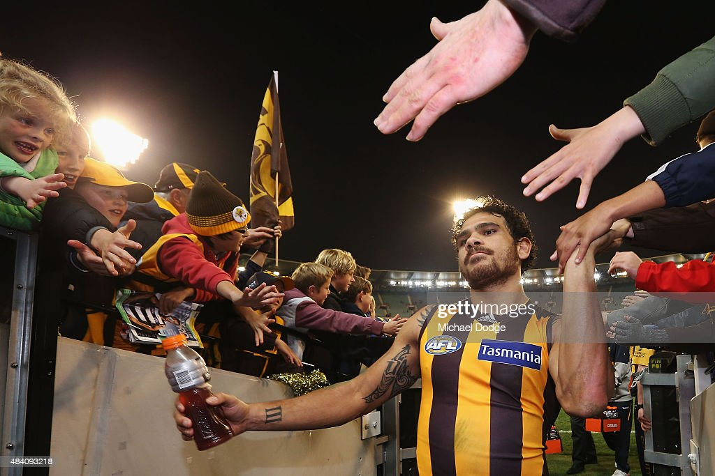 Cyril Rioli of the Hawks celebrates the win with fans during the round 20 AFL match between the Geelong Cats and the Hawthorn Hawks at Melbourne Cricket Ground on August 15, 2015 in Melbourne, Australia.