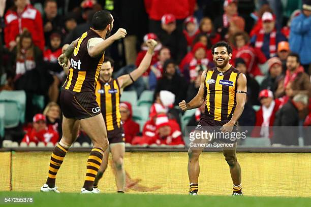 Cyril Rioli of the Hawks celebrates with team mates after winning the round 17 AFL match between the Sydney Swans and the Hawthorn Hawks at Sydney...
