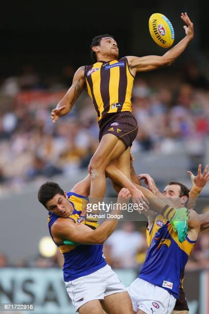 Cyril Rioli of the Hawks compete for the ball over Tom Barrass of the Eagles and Shannon Hurn of the Eagles during the round five AFL match between...