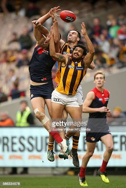Cyril Rioli of the Hawks contests the mark with Max Gawn of the Demons during the 2016 AFL Round 20 match between the Melbourne Demons and the...