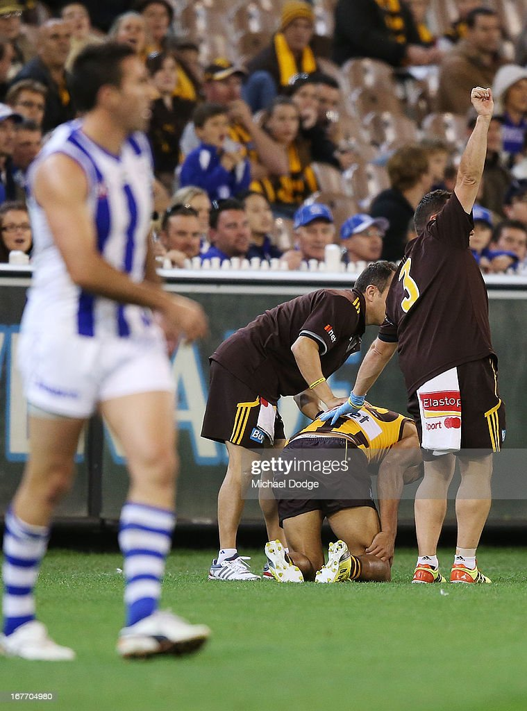 Cyril Rioli of the Hawks injures his right hamstring during the round five AFL match between the Hawthorn Hawks and the North Melbourne Kangaroos at Melbourne Cricket Ground on April 28, 2013 in Melbourne, Australia.