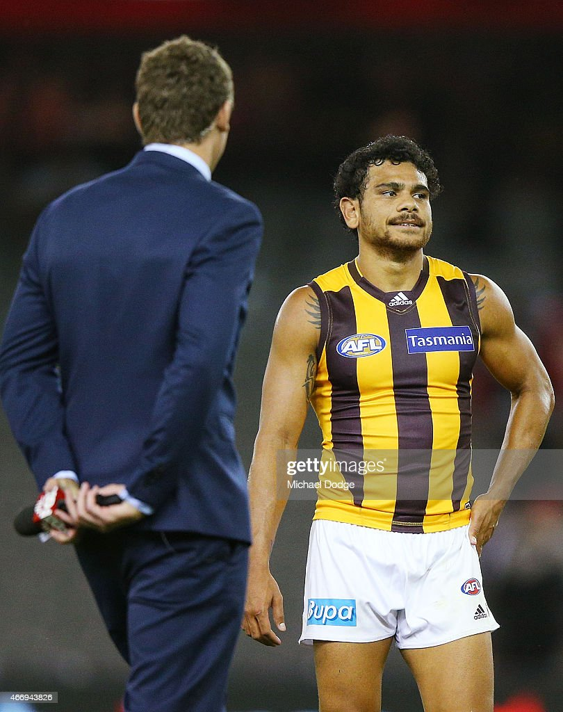 Cyril Rioli of the Hawks is approach by Cameron Mooney of Fox Footy for an interview after their win during the NAB Challenge AFL match between St Kilda Saints and Hawthorn Hawks at Etihad Stadium on March 19, 2015 in Melbourne, Australia.