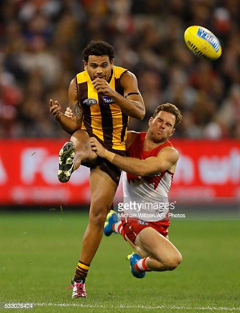 Cyril Rioli of the Hawks is tackled by Ben McGlynn of the Swans during the 2016 AFL Round 09 match between the Hawthorn Hawks and the Sydney Swans at...