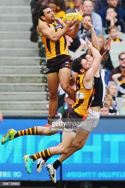 Cyril Rioli of the Hawks marks the ball during the round 23 AFL match between the Hawthorn Hawks and the Collingwood Magpies at Melbourne Cricket...