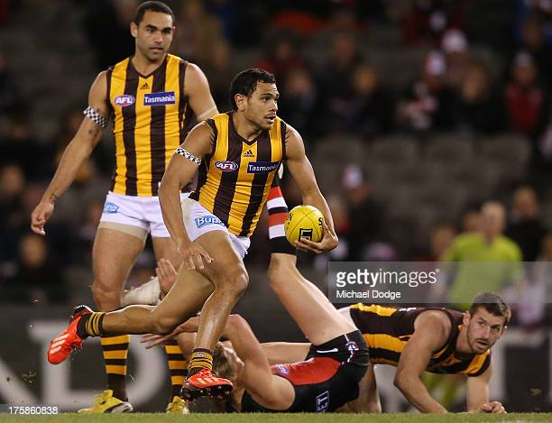Cyril Rioli of the Hawks runs with the ball during the round 20 AFL match between the St Kilda Saints and the Hawthorn Hawks at Etihad Stadium on...
