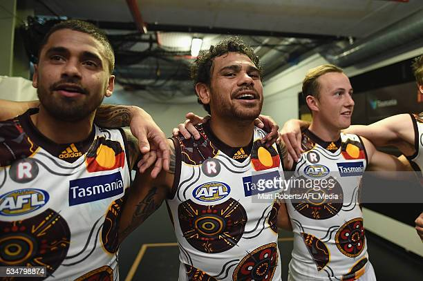 Cyril Rioli of the Hawks sings the team song with team mates after the round 10 AFL match between the Brisbane Lions and the Hawthorn Hawks at The...