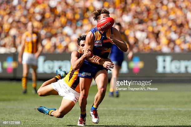 Cyril Rioli of the Hawks tackles Mark Hutchings of the Eagles during the 2015 AFL Grand Final match between the Hawthorn Hawks and the West Coast...