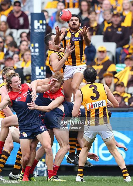 Cyril Rioli of the Hawks takes a spectacular mark in the 2nd quarter during the round 20 AFL match between the Melbourne Demons and the Hawthorn...