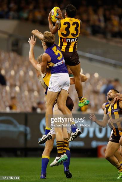 Cyril Rioli of the Hawks takes a spectacular mark over Nathan Vardy of the Eagles during the 2017 AFL round 05 match between the Hawthorn Hawks and...