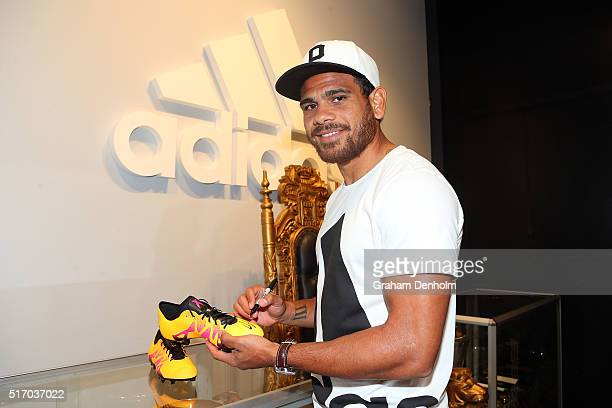 Cyril Rioli of the Hawthorn Hawks signs his autograph at the new adidas Bourke Street Store on March 23 2016 in Melbourne Australia