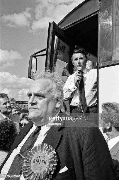 Cyril Smith looks on as Liberal leader David Steel gives a speech to the waiting crowds from the steps of his battle bus as it reaches Rochdale...