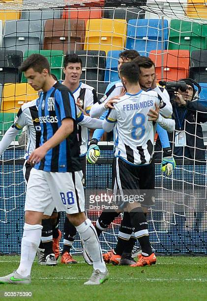 Cyril Thereau of Udinese Calcio celebrates with his team mate's after scoring his opening goal during the Serie A match between Udinese Calcio v...