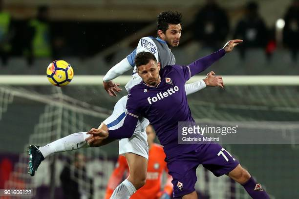 Cyril Thereau of ACF Fiorentina battles for the ball with Andrea Ranocchia of FC Internazionale during the serie A match between ACF Fiorentina and...