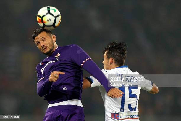 Cyril Thereau of ACF Fiorentina battles for the ball with Marten De Roon of Atalanta BC during the Serie A match between FC Crotone and Benevento...