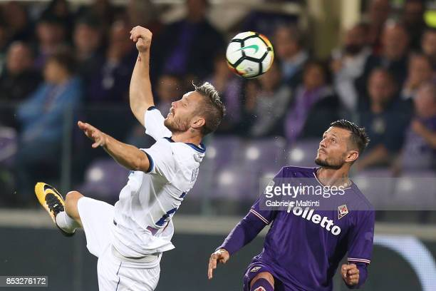 Cyril Thereau of ACF Fiorentina in action agaist Jasmin Kurtic of Atalanta BC during the Serie A match between FC Crotone and Benevento Calcio at...